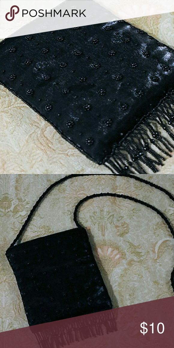 Beaded purse Beautiful black, beaded purse w/ beaded fridge. Beaded rope strap. Great for prom, or formal events. No beads missing. Small pocket inside. Smoke free home. La Regale Bags Shoulder Bags