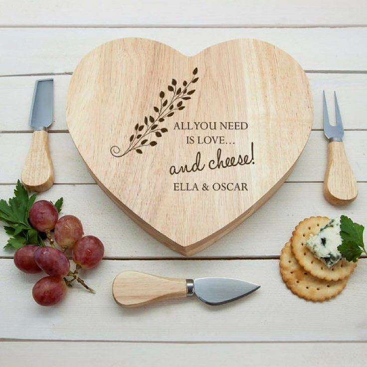 This super cute cheese board is the perfect #wedding or #housewarming #gift! Plus you can personalise it with the couples' names for an added special touch. #giftsforfriends #personalisedgifts #giftideas #giftshop #weddinggift