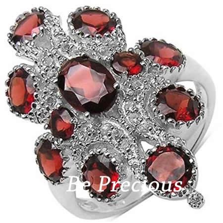 Inel superb cu granate si topaze, marca BE Precious, disponibil online la http://www.beprecious.ro/bijuterii-argint/inele-argint.php .