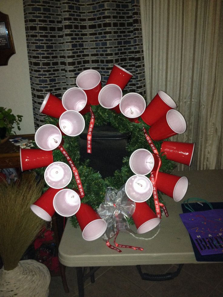 Red Solo cup wreath I made for a gift exchange. One light string 20 lights, ribbon and also ...