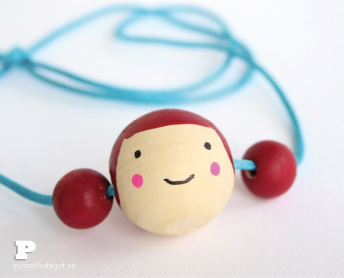 make a doll face necklace