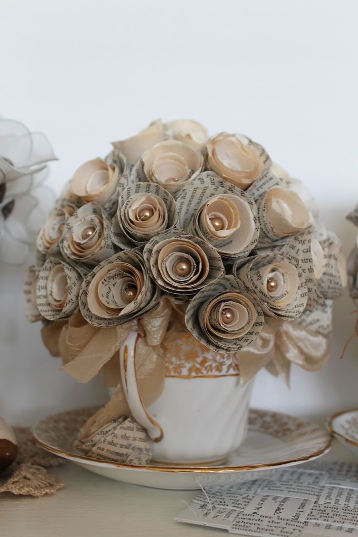 A bunch of paper flowers in a cup.