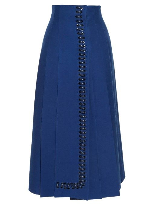Fendi focused on meticulous craftsmanship and intricate details for SS16. A stand-out piece from the runway, this cobalt-blue midi skirt is crafted to a flattering high-waisted shape, and sharply pleated for movement. A trim of black leather whipstitching runs along the front, providing that artisanal finish. Tuck in a voluminous white blouse, and add height with black platforms.