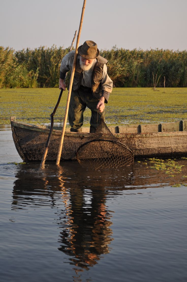 Romanian fisherman in Danube Delta.