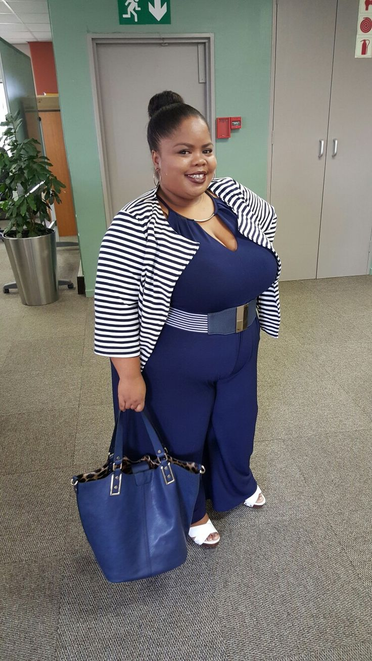 Wearing navy jumpsuit, striped belt and top all from city chic South Africa... styled by Molebo