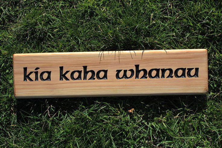Kia kaha whanau, macrocarpa wooden sign