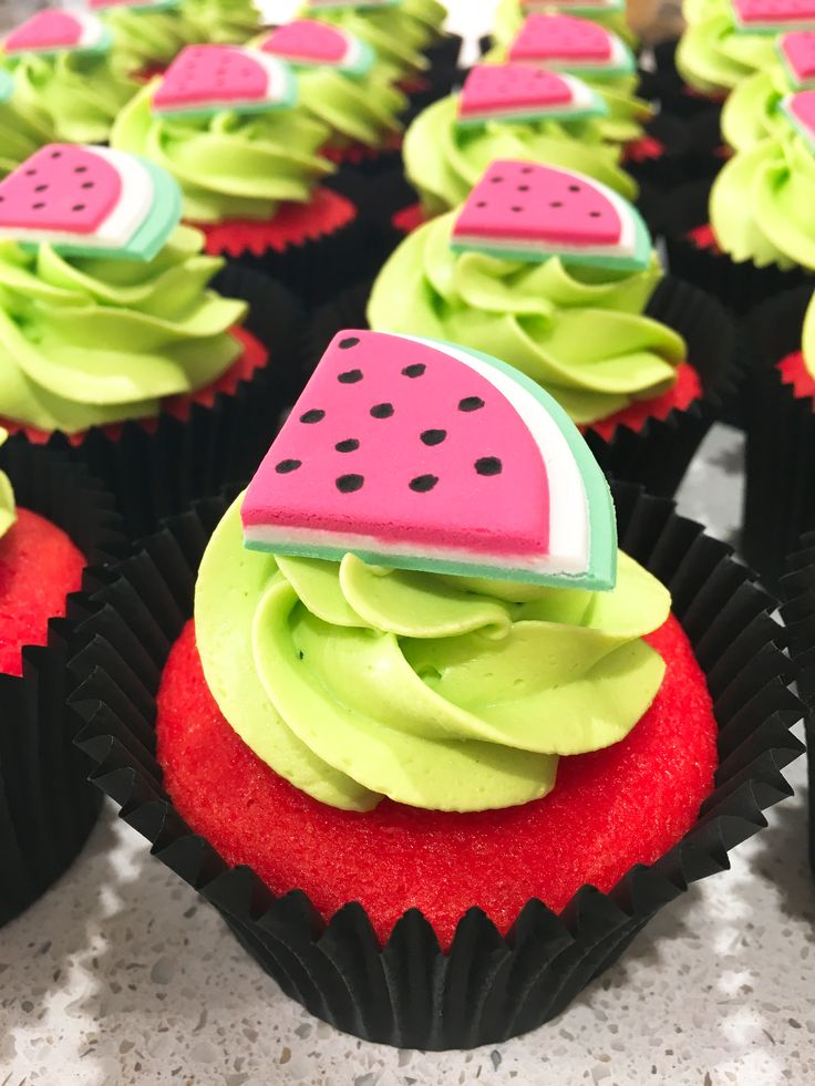 Watermelon cupcakes  Butter cake tinted red Buttercream tinted electric green by AmeriColor Watermelons made from fondant