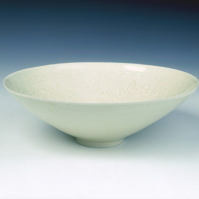Ding bowl with phoenixes amid camellia scrolls, Jin dynasty, China, late 12th century.
