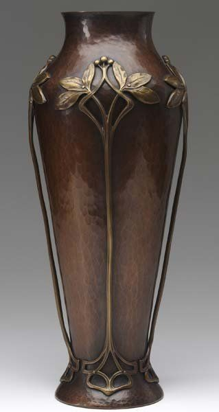 "WMF Art Nouveau hammered copper vase with applied cast-brass leaf and berry branches, stamped mark, along with 184, 15 1/4"" H."