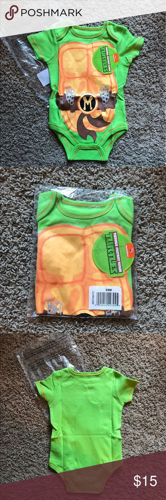 Teenage Mutant Ninja Turtles onesie Brand new item never even removed from packaging. Received it as a gift and forgot about it until it was too late. Taking these pictures was the first time I took it out of the package. Fits 3-6 months or up to 20lbs. Nickelodeon One Pieces Bodysuits