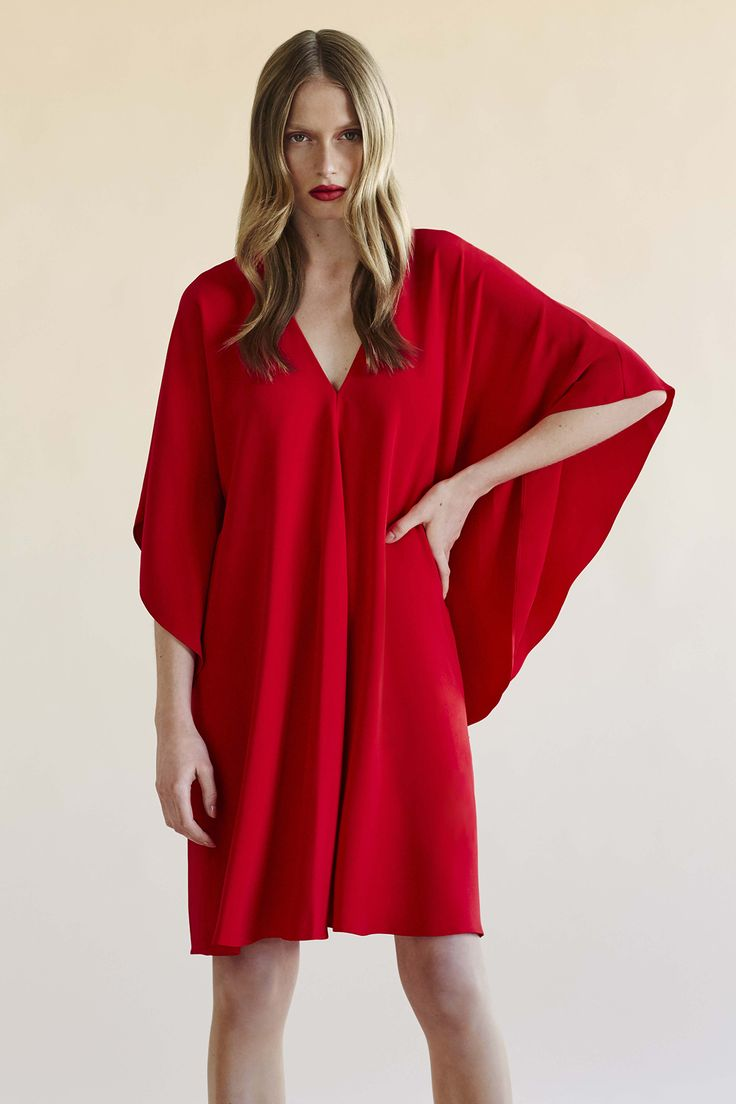 Bring a little power to your summer dress with statement sleeves and gorgeous red.