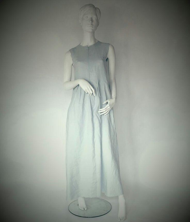 Peace Lily sleeveless linen dress with pleats.