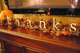 Thanksgiving Mantel: Dollar store glasses, sticker letters, fill with cinnamon sticks, pine