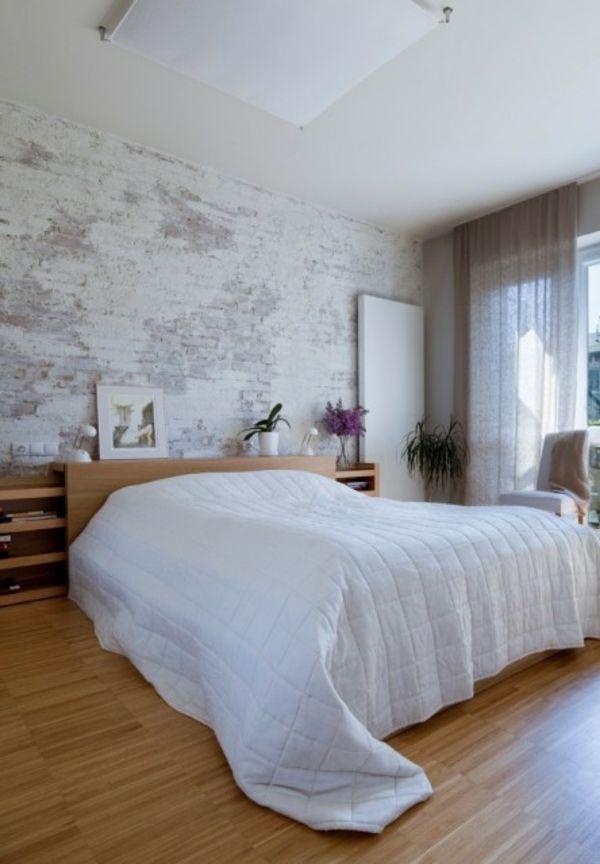 Eine Backstein Mauer in City Stil und in weiß und grau