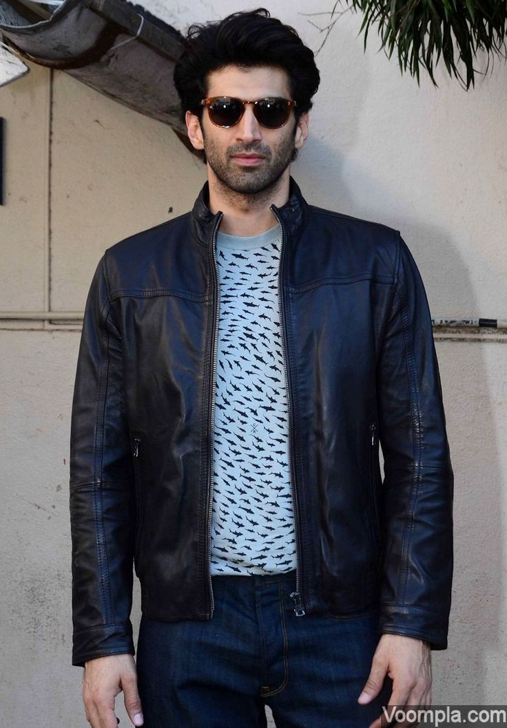 Aditya Roy Kapur looks too cool in a black jacket, jeans and a quirky fish print T-shirt. via Voompla.com