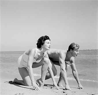 Actor John Smith and actress Sharon Dexter pose on the beach in Los Angeles,CA.
