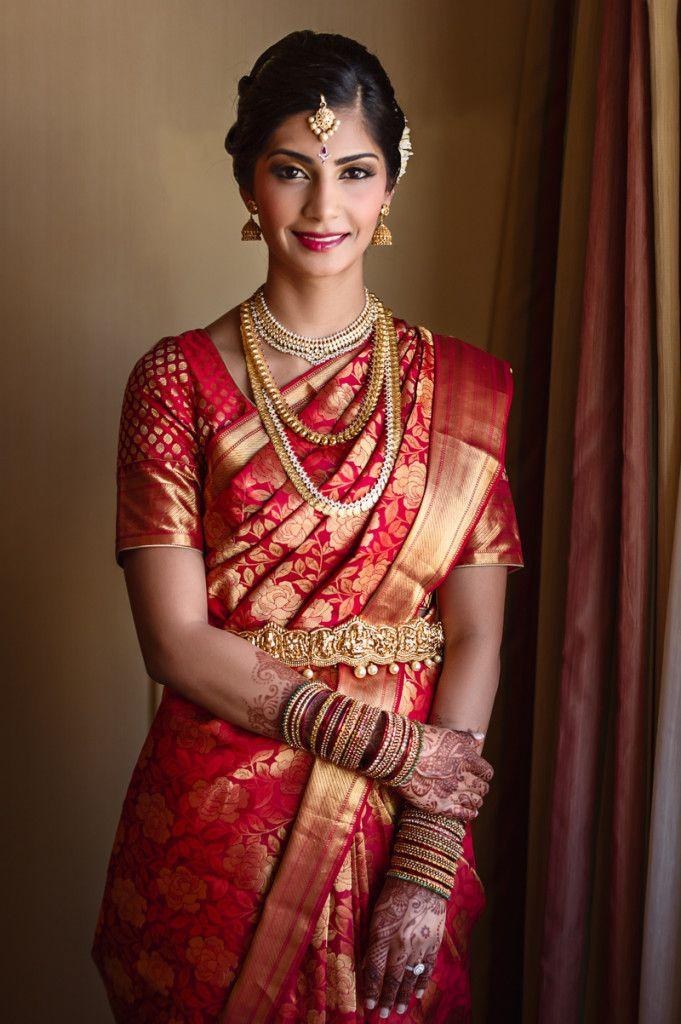 South Indian bride. Temple jewelry. Beautiful red Kanchipuram silk sari.Braid with fresh flowers. Tamil bride. Telugu bride. Kannada bride. Hindu bride. Malayalee bride.