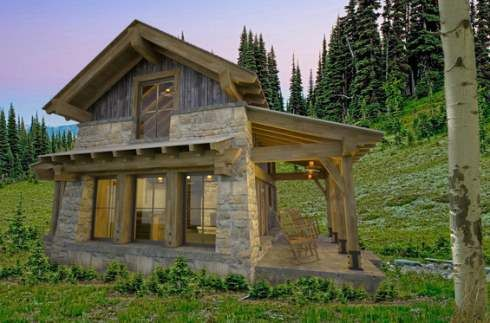 Designed by Stuart Arc, a Steamboat Springs architectural firm, it features a stone and timber exterior pierced by large glazed openings.  Weathered board and batten siding lends additional texture to the upper gable ends.