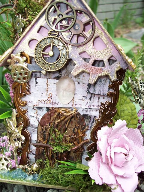 ebay fairy Houses   Steampunk stickers down the sides and gold swirls are Jolees.