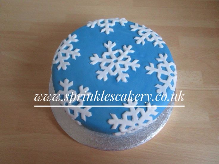 A rich rum fruit cake covered with marzipan and fondant and decorated with handmade fondant snowflakes.