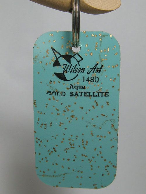"Vintage Wilson Art laminate samples used as key rings. ""Gold Satellite""? Yes, please 