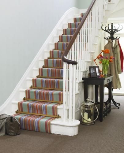 Striped runner with plain entrance hall carpet