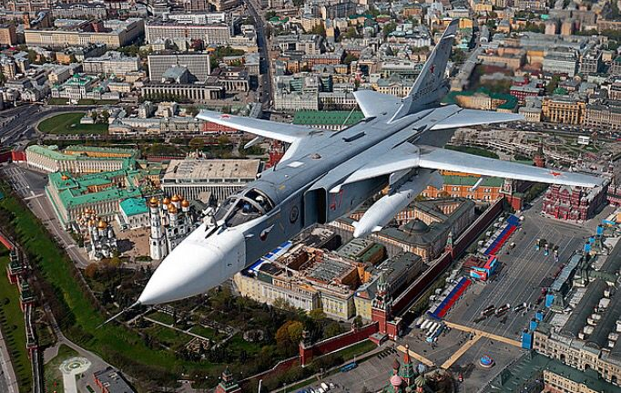 A Russian Air Force Sukhoi Su-24M Fencer flies over Moscow.