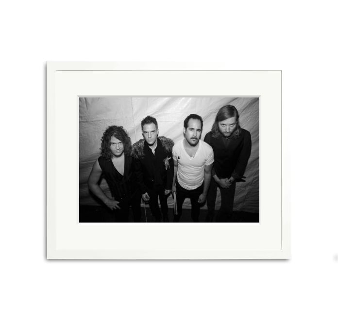 Dave Keuning, Brandon Flowers, Ronnie Vannucci Jr. and Mark Stoermer of The Killers pose backstage before performing during the 2009 Lollapalooza music festival in Chicago, Illinois.