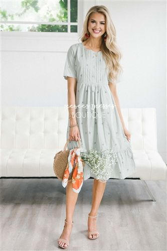 a3a812ab47b6 This pastel sage dress is a must have this fall! The Oaklynn features small  embroidered dandelion floral print, a button front with pleated detail, ...