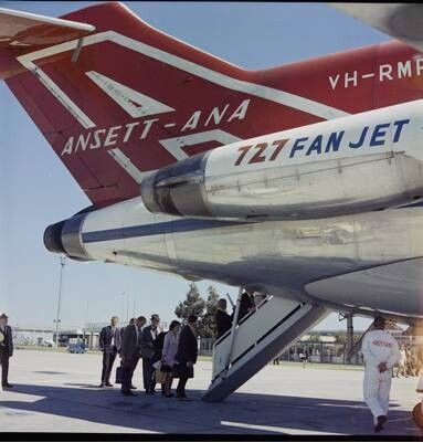 Ansett-ANA B727 boarding through tail entry. Perth Airport