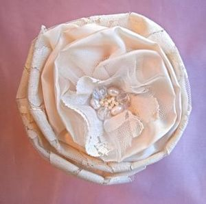 Taffeta and lace, freshwater pearls and crystal.