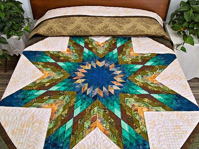 I love the quilts By Delores Yoder. She is an Amish women and the detail work is wonderful.