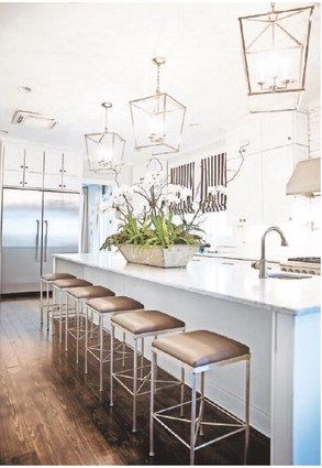 Polished nickel lanterns hang above the 13-foot-long island in the kitchen.