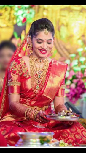 South Indian bride. Gold Indian bridal jewelry.Temple jewelry. Jhumkis.Red silk kanchipuram sari with contrast green blouse.braid with fresh jasmine flowers. Tamil bride. Telugu bride. Kannada bride. Hindu bride. Malayalee bride.Kerala bride.South Indian wedding.