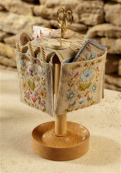 Very interesting project from UK. Beasts & Flowers Scissor Stand - This cleverly constructed stitcher's treasure is made up of four stitched pockets worked on unbleached linen band. The stitches include cross stitch, backstitch, queen stitch, French knots, four sided stitch, hemstitch & bullion bars.