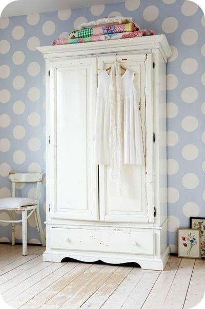 Love the awesome armoire and the polka-dotted wallpaper
