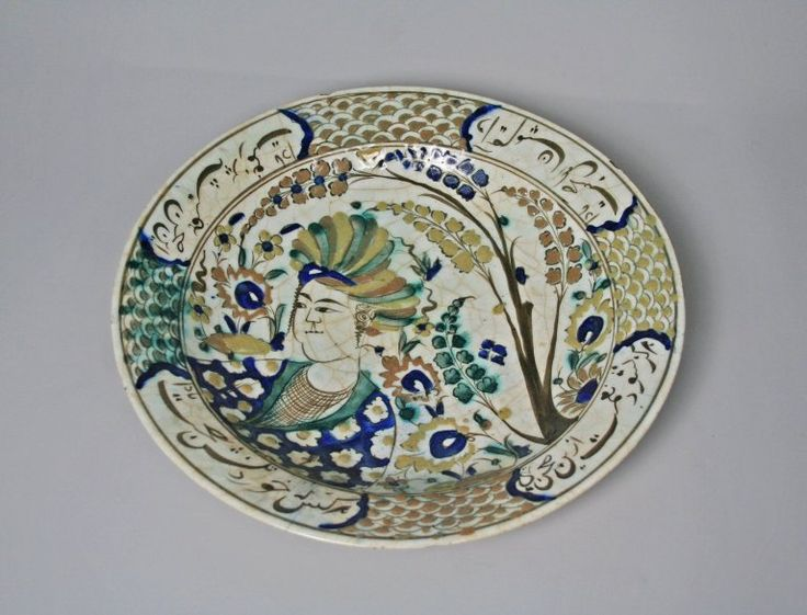 Dish Depicting Turbaned Youth and Persian Poetic Inscriptions, early 17th century. Ceramic, slip, underglaze, glaze, 13 5/8 x 2 9/16 in. (34.6 x 6.5 cm). Brooklyn Museum, Gift of Mrs. Horace Havemeyer, 42.212.31. Creative Commons-BY (Photo: Brooklyn Museum, CUR.42.212.31_top.jpg)