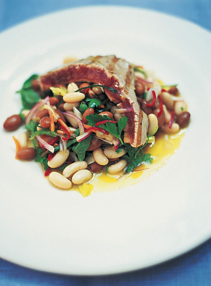 This is a really beautiful summer dish that takes hardly any time at all to prepare – and, of course, you can use different kinds of beans, such as black-eyed beans, flageolets, butter beans or even lentils. It's a terrific hot snack or main dish – and with the tuna all torn up it makes a great salad. I like to griddle the tuna for a minute on each side so it has colour on the outside but still remains a little pink in the middle. A lot of people still want to cook tuna all the way through…