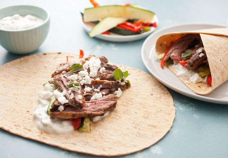 Grilled Greek Steak Wraps: Marinated and grilled skirt steak with loads of grilled veggies and a quick tzatziki sauce. A hearty and delicious wrap!