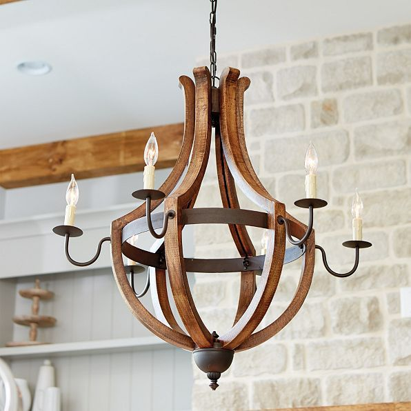 Warm, rustic texture for the entry, dining area or living room. Inspired by the casual comfort of the Italian countryside, our Tuscany Chandelier is hand crafted of wood and iron.