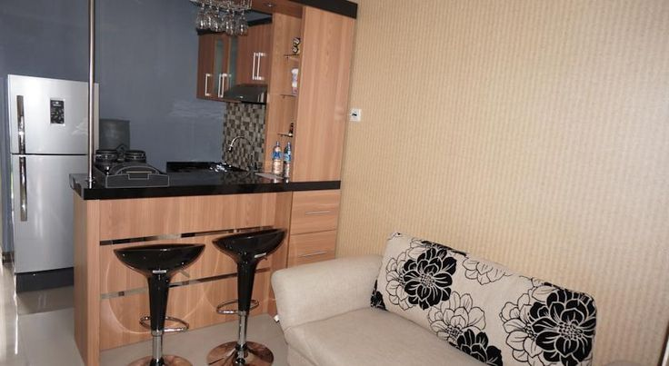 Fully occupied minibar and living area. http://www.booking.com/hotel/id/safa-homestay.html?aid=806951