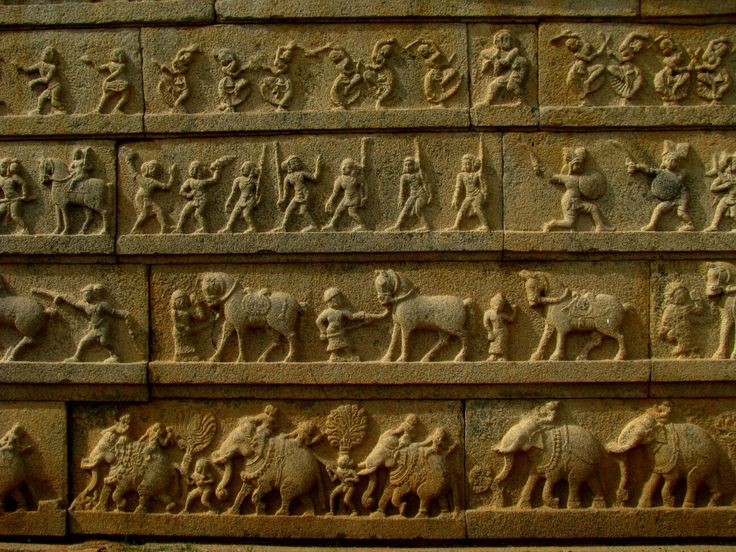 Horizontal friezes in relief on the outer wall enclosure of Hazara Rama temple, depicting life in the kingdom