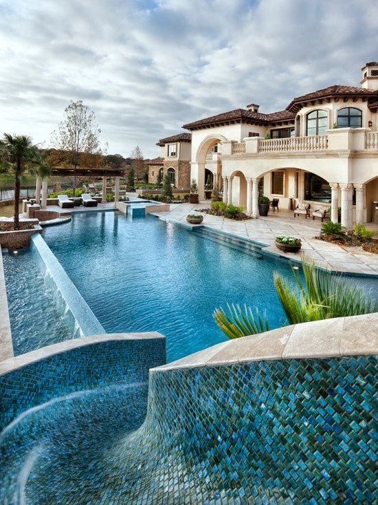 Mediterranean inspired luxury home and pool.  Who's ready to take a dip?