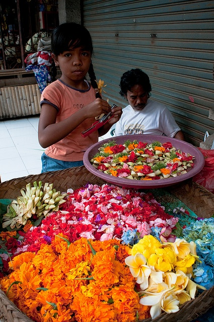 Preparing offerings to the gods in Bali