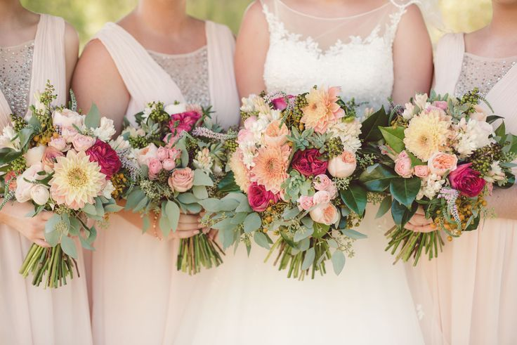 floral arrangements buy signature floral designs. wedding dress by Tuscany Bridal and Bridesmaids by Ally Fashion.