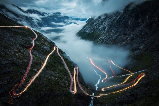 #TROLLSTIGEN by Christoph Schaarschmidt #Photocircle #fineart #photoart from #Norway #naturephotography #view #cars #serpentines #lighttrails #mountains #longexposure #colors #Closethecircle - if you buy this photo Christoph Schaarschmidt and Photocircle #donate 9% to improve #education in #Germany