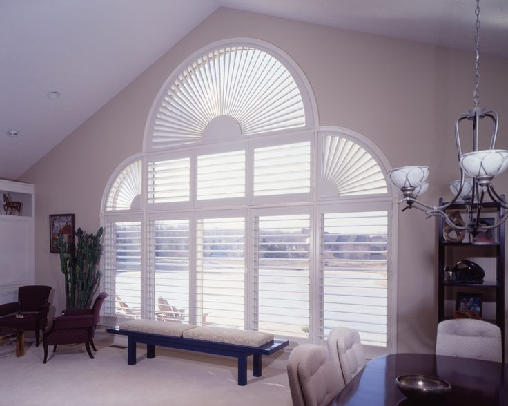 Lafayette Woodland Harvest Wood Shutters - Plantation Shutters - Living room window ideas- This window array in the living room has a half moon window & two quarter moon windows with specialty wood shutters. Windows Dressed Up in Denver, located at 38th on Tennyson St, has a large selection of wood blinds, wood shutters and wood shades. Visit our showroom and talk to a Certified Interior Designer and get more window treatment ideas for your next project.