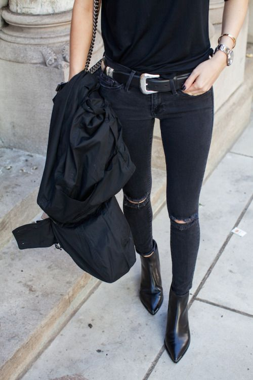 Black on black. Get the look with black jeans, booties, a tee shirt, and a stylish belt.