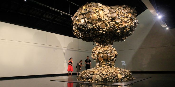 """Cloud Burst"" created by the Indian artist Subodh Gupta in the shape of a mushroom cloud that extends over a 5 meter radius by collecting large amounts of stainless-steel utensils and home objects."