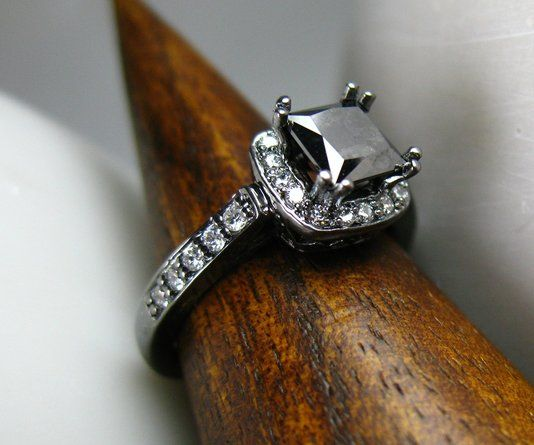 This black gold and black diamond engagement ring is striking and unique.